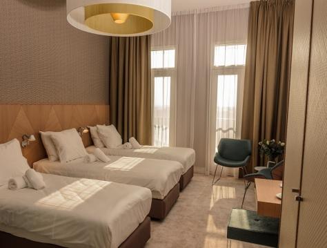 Deluxe üç kişilik oda